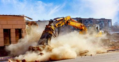 Crane Demoloshing building creating dust