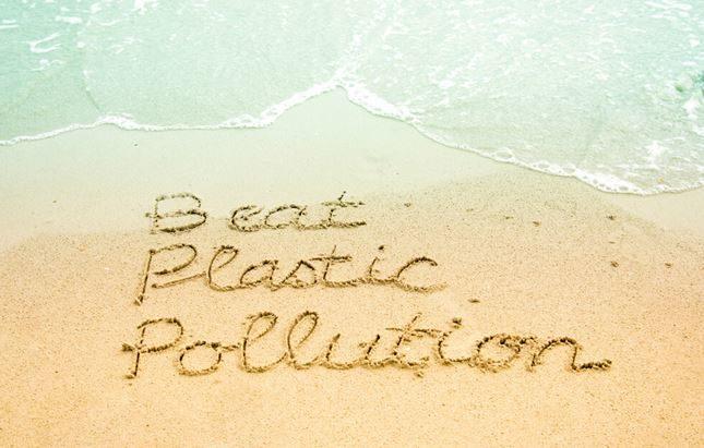 Beat Plastic Pollution written on beach