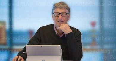 Bill Gates Using a Laptop