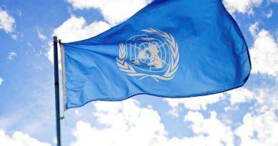 UN Flag blue sky BG
