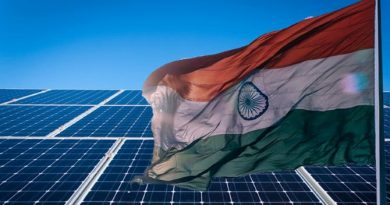 Solar Panels behind the Indian Flag